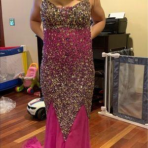 Size 14 prom dress it's like a purplish pink color